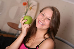 Happy woman with a green apple Stock Photo