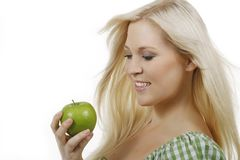 Happy woman with green apple. Isolated on white royalty free stock photography