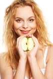 Happy woman with green apple Royalty Free Stock Image