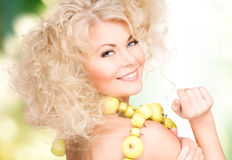 Happy woman with green apples Royalty Free Stock Photos