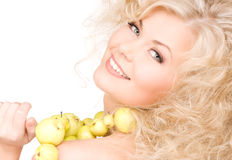 Happy woman with green apples Stock Images