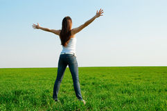 Happy woman at the green field Royalty Free Stock Images
