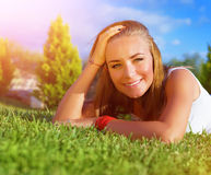 Happy woman on green grass Royalty Free Stock Photography