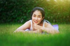 Happy woman on the green grass field Royalty Free Stock Photo