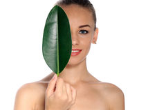 Happy woman with green leaf Stock Photo