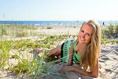 Happy woman in green sundress Stock Photos
