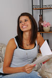 Happy woman with a greeting card Royalty Free Stock Photography