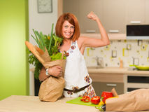 Happy woman with grocery bag Stock Image