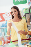 Happy woman with grocery receipt Royalty Free Stock Image