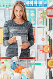 Happy woman with grocery receipt Stock Image