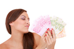 Happy woman with group of euro bills Isolated. Royalty Free Stock Image