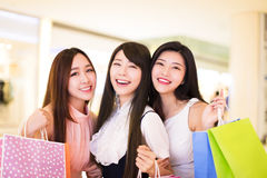 Happy woman group holding shopping bags Royalty Free Stock Images