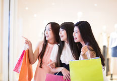 Happy woman group holding shopping bags Stock Image