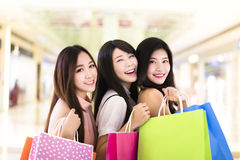 Happy woman group holding shopping bags Stock Images