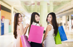 Happy woman group holding shopping bags Stock Photo