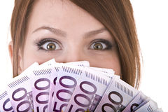 Happy woman with group of money. Royalty Free Stock Image