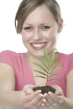 Happy woman with growing plant Royalty Free Stock Photo