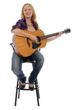 Happy woman with a guitar stock image