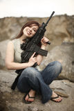 Happy woman with gun. Stock Images