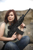 Happy woman with gun. Royalty Free Stock Photography
