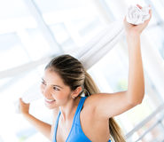 Happy woman at the gym Stock Images