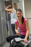 Happy woman at gym's locker room Royalty Free Stock Images