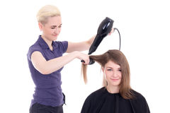 Happy woman hair stylist doing haircut to client isolated on whi Royalty Free Stock Images