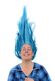 Happy woman with hair up. Happy woman with a huge grin showing her teeth with her blue hair up in the air stock photography