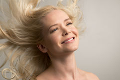 Happy woman haircare Royalty Free Stock Image
