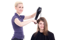 Happy woman hairdresser doing haircut to client isolated on whit Stock Photos