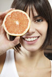 Happy Woman With Half Grapefruit In Front Of Face Stock Image