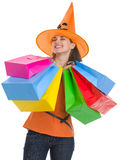 Happy woman in Halloween hat with shopping bags Stock Photos