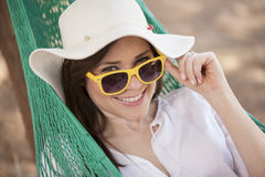 Happy woman in a hammock Stock Photos