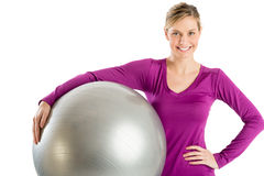 Happy Woman With Hand On Hip Holding Pilates Stock Photography