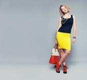 Happy woman with handbag Stock Photos