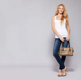 Happy woman with handbag Royalty Free Stock Image