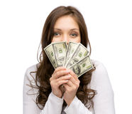 Happy woman handing money Stock Images