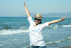 Happy woman with hands in the air Stock Images