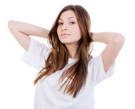 Happy  woman with hands behind neck Stock Photography