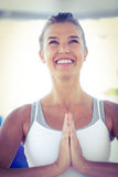 Happy woman with hands joined. In fitness studio royalty free stock photo