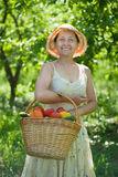 Happy  woman with  harvested vegetables Royalty Free Stock Photos