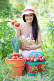 Happy woman with harvested vegetables Stock Images