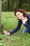 Happy woman has just found a mushroom Stock Photography