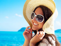 Happy woman in hat on the beach Stock Photos
