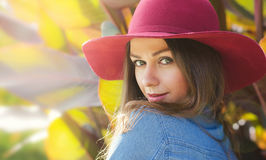 Happy woman in a hat. Close portrait. Autumn portrait in an outdoor garden. stock photo
