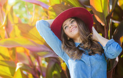 Happy woman in a hat. Close portrait. Autumn portrait in an outdoor garden. royalty free stock images