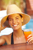 Happy woman with hat and cocktail Royalty Free Stock Images