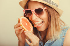Happy woman in hat drinking grapefruit juice. Diet Royalty Free Stock Image