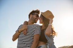Happy woman in hat embracing her boyfriend smiling. Portrait of happy women in hat embracing her boyfriend smiling Stock Photo