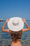 Happy woman with hat enjoying beach Stock Photo